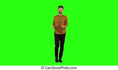 Man is dancing energetically, he is having fun. Green screen. Slow motion