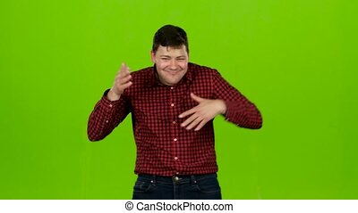 Man is dancing energetically, he is having fun. Green screen