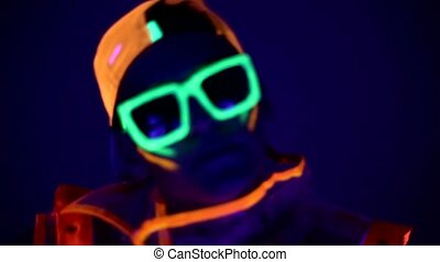 Man is dancing in neon clothes close up