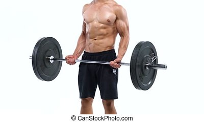 Man is doing exercises with a barbell, training on a white...