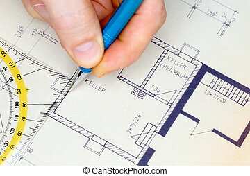 man is drawing a blue print