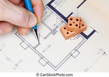 man is drawing a house plan