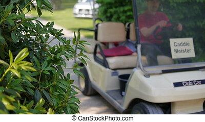 Man is driving a golf car