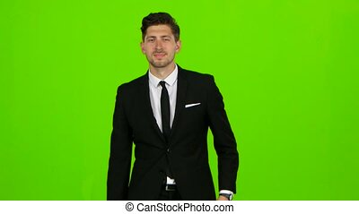 Man is going to a business meeting and waving greetings. Green screen