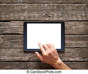 Man is going to touch screen of digital tablet