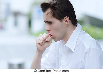 Man is having a cough caused by pollen allergy