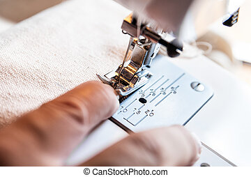 man is having a nasty accident with a sewing machine