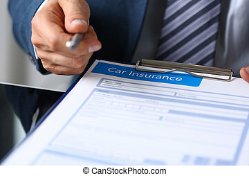 Man is holding car insurance claim form