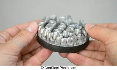 Man is holding object printed on metal 3d printer. Dental...