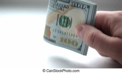 Man is holding stack of dollars in his hand