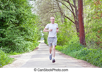 man is jogging in the forest