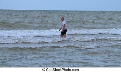 Man is jumping over the waves