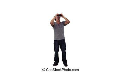 Man is looking through binoculars