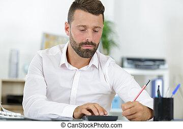 man is looking through drafts