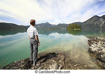 man is looking to lake walchensee in Bavaria