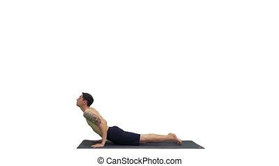 Man is making yoga poses on white background.