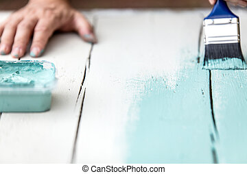 man is painting in shabby chic look