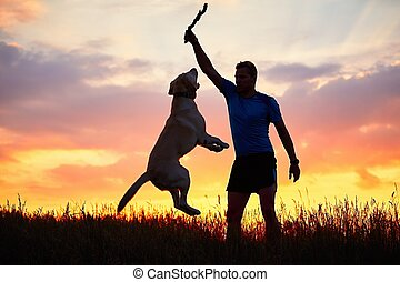 Man is playing with dog