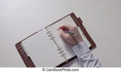 Man is preparing to writing notes in notebook. Part 04.
