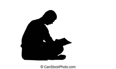 Man is reading a book. White background. Silhouette