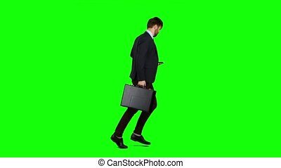 Man is running to work, understands that he is late and begins to run. Green screen