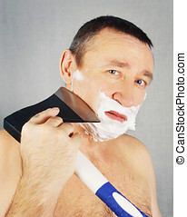 Man is shaving with axe
