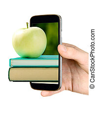 Man is showing book with apple through mobile phone