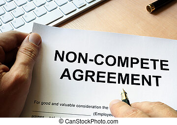 Man is signing Non compete agreement.