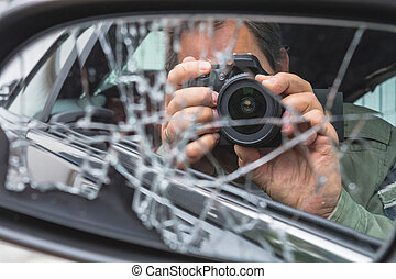 Man is sitting in the car with dslr camera and photographing