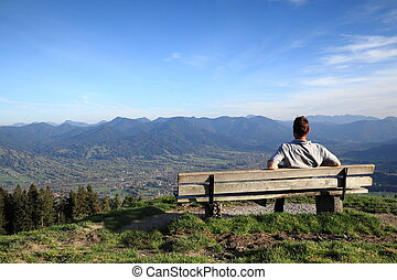 man is sitting on a bench