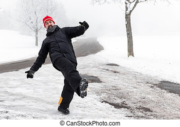 Man is slipping on a icy road - Man is slipping on a icy...