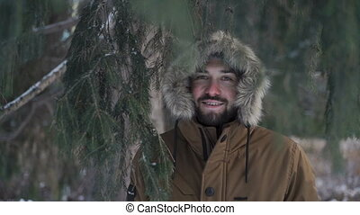 Man is smiling standing in the park