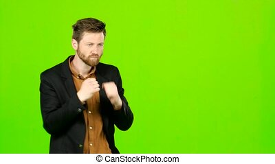 Man is standing in a rack and boxing. Green screen - Man in...