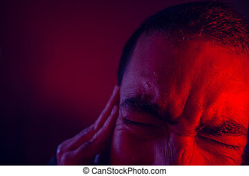 Man is suffering in pain from headache