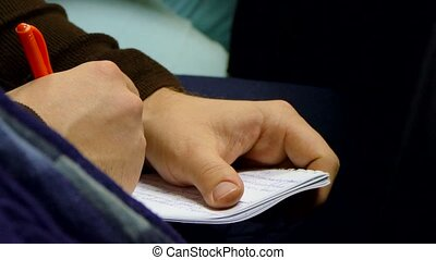 man is taking notes in his notebook - a man is taking notes...