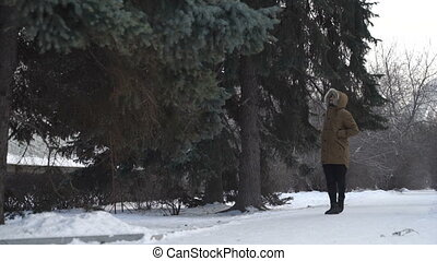 Man is walking through the forest