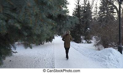 Man is walking through the park
