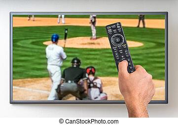 Man is watching baseball match on TV