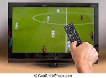 Man is watching football match on TV