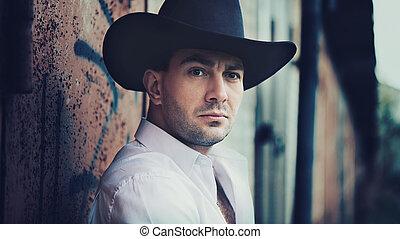 man is wearing a cowboy hat