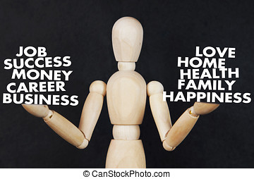 Man is weighing on his hands a career and family values. Abstract image with wooden puppet