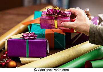 man is wrapping a gift