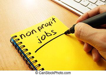 Man is writing non profit jobs. - Man is writing non profit...