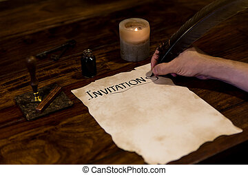 Man is writing on a document Invitation