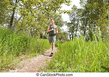 Man jogging in forest