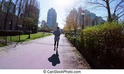 Man jogging in the city 4k - Man jogging in the city on a...