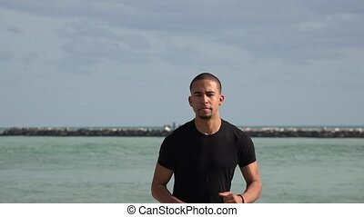 Man Jogging Near Ocean