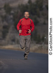 Man Jogging On A Road
