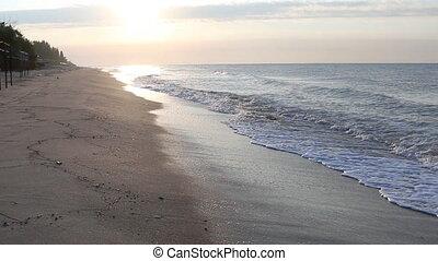 Man jogging on beach at sunrise