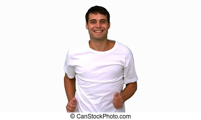 Man jogging on white screen in slow motion
